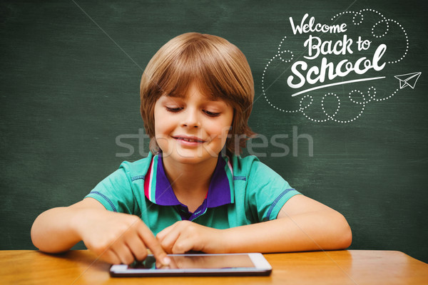 Composite image of pupil using tablet pc Stock photo © wavebreak_media