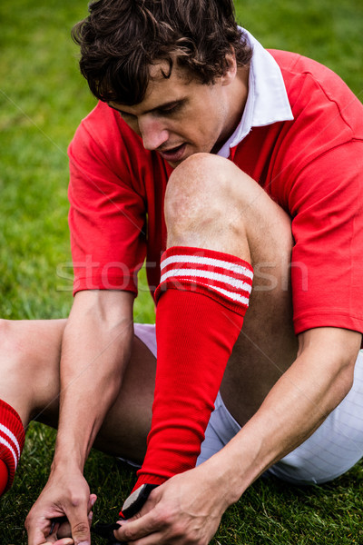 Rugby player sitting on grass Stock photo © wavebreak_media