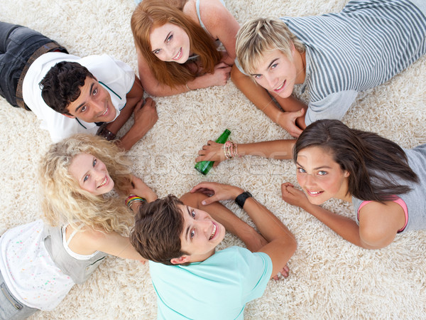 Group of teenagers playing spin the bottle Stock photo © wavebreak_media
