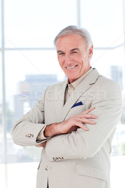 Attractive senior businessman with folded arms Stock photo © wavebreak_media
