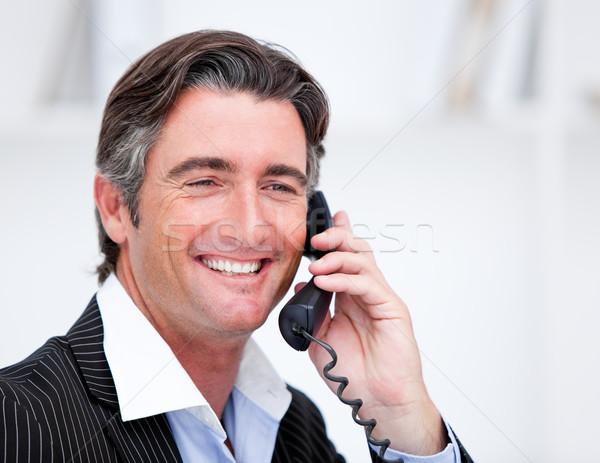 Przystojny dojrzały biznesmen mówić telefonu posiedzenia Zdjęcia stock © wavebreak_media