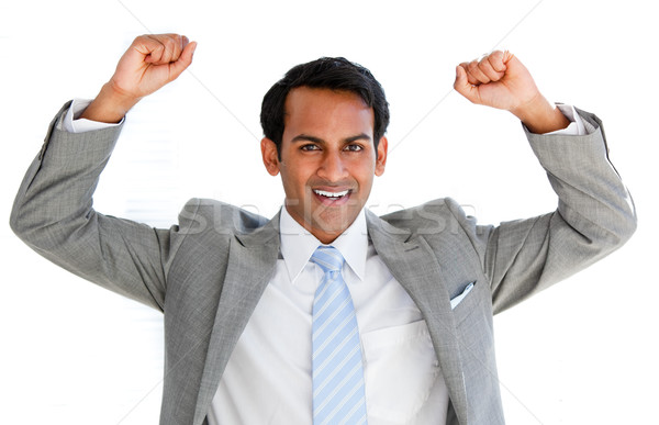 Jolly businessman punching the air in celebration Stock photo © wavebreak_media