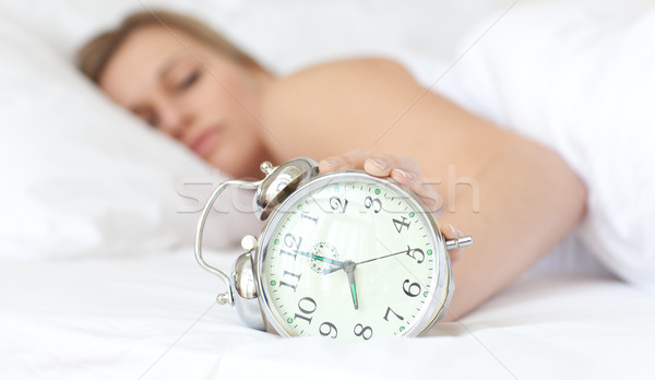 Blond woman holding an alarm clock  Stock photo © wavebreak_media