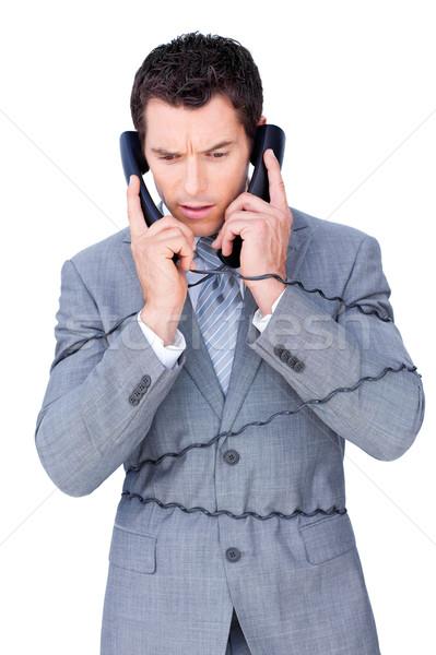 Zakenman omhoog telefoon draden geïsoleerd Stockfoto © wavebreak_media