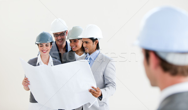 Male Engineer looking back at his smiling colleagues Stock photo © wavebreak_media