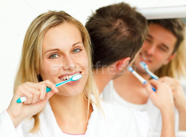 Couple cleaning their teeth Stock photo © wavebreak_media