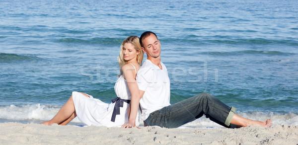 Romantic couple sitting on the sand  Stock photo © wavebreak_media