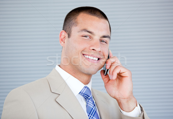 Assertive businessman talking on phone Stock photo © wavebreak_media
