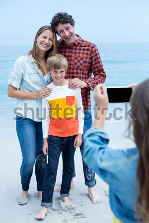 Family giving children piggyback ride  Stock photo © wavebreak_media