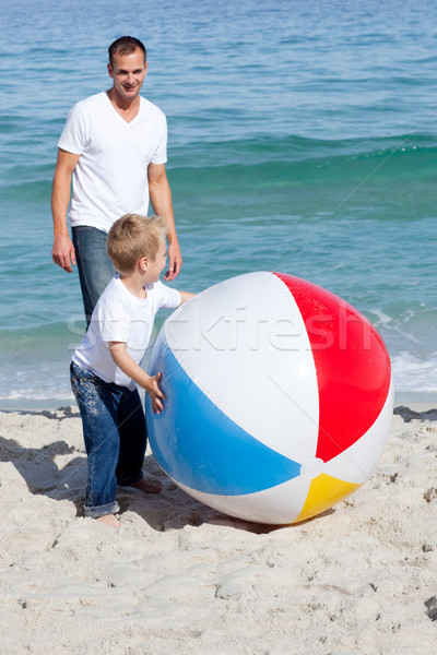Smiling father and his son playing with a ball Stock photo © wavebreak_media