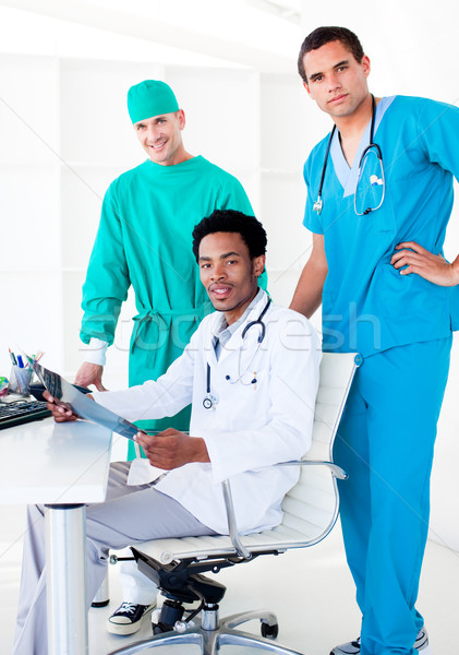 Assertive male doctors looking at X-Ray Stock photo © wavebreak_media