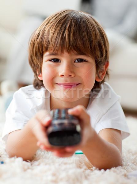 Mosolyog kicsi fiú néz tv padló Stock fotó © wavebreak_media
