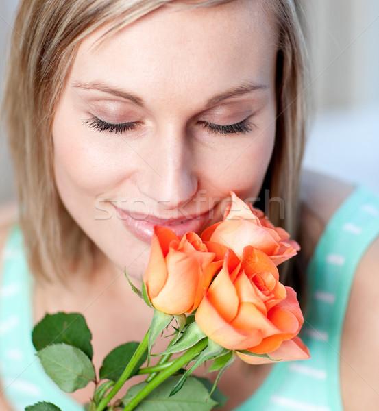 Gülümseyen kadın güller ev çiçek bahar yüz Stok fotoğraf © wavebreak_media