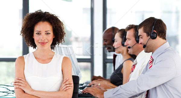 Attractive businesswoman with folded arms in a call center Stock photo © wavebreak_media