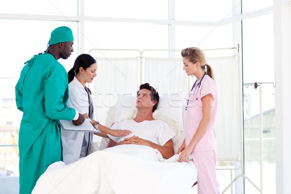 Doctors caring for a patient Stock photo © wavebreak_media