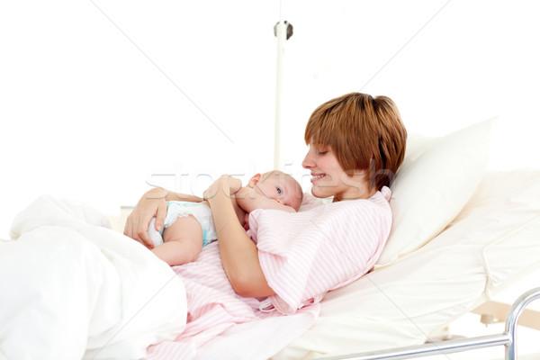 Smiling patient with newborn baby in bed Stock photo © wavebreak_media