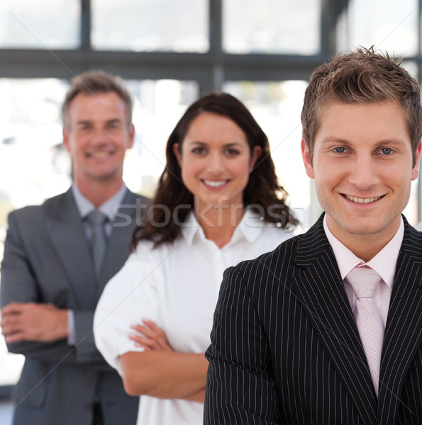 Souriant équipe commerciale regarder caméra bureau affaires Photo stock © wavebreak_media