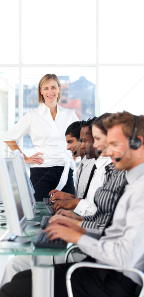 Caucasian female manager leading her representative team in a office Stock photo © wavebreak_media