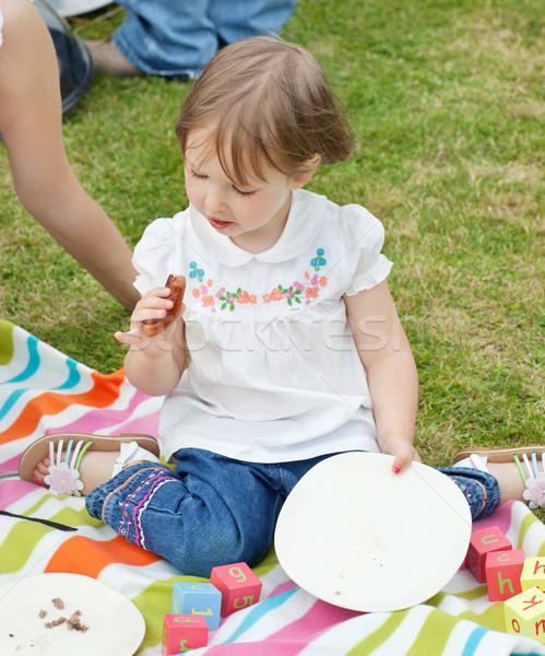 Portré kislány piknik kert lány mosoly Stock fotó © wavebreak_media