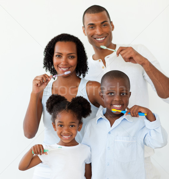 Afro-american family brushing their teeth in the bathroom Stock photo © wavebreak_media