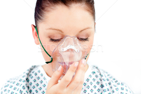 Diseased caucasian  woman wearing a mask against white background Stock photo © wavebreak_media
