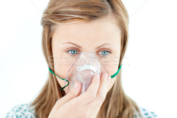 Diseased young woman wearing a mask against white background Stock photo © wavebreak_media
