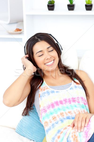 Vrouw luisteren muziek hoofdtelefoon Stockfoto © wavebreak_media