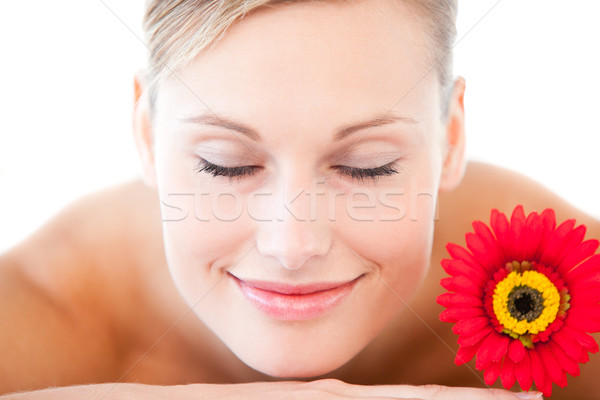 Close-up of a smiling woman lying on a massage table with a flower in a health spa Stock photo © wavebreak_media