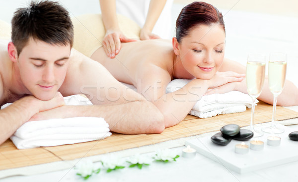 Charming young couple enjoying a back massage in a spa center Stock photo © wavebreak_media