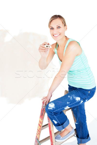 Animated woman painting a room in her new house Stock photo © wavebreak_media