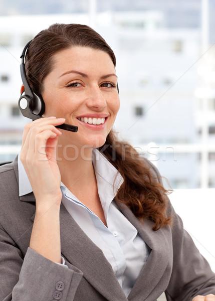 Sorrindo falante fones de ouvido escritório mulher menina Foto stock © wavebreak_media
