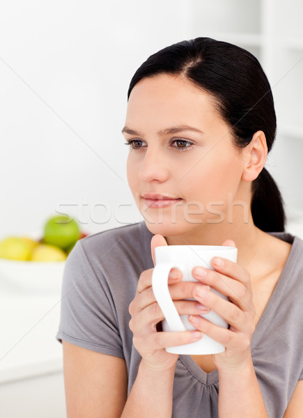Quiet woman drinking her coffee in the kitchen at home Stock photo © wavebreak_media