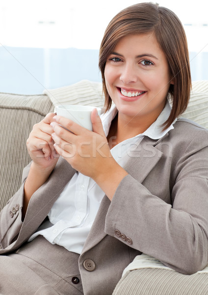 Businesswoman drinking coffee at home Stock photo © wavebreak_media