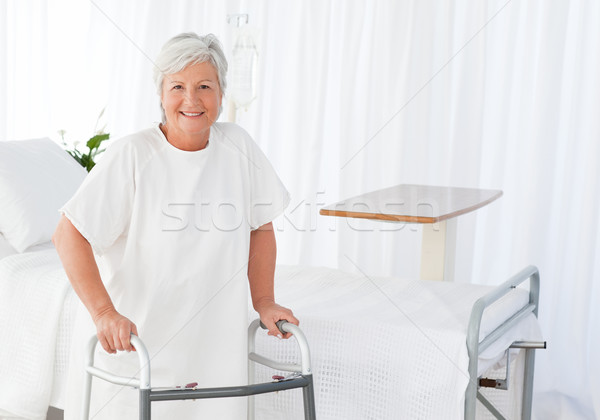 Stock photo: Senior woman looking at the camera with her zimmer frame