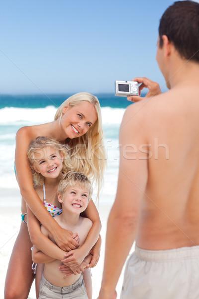 Man taking a photo of his family Stock photo © wavebreak_media