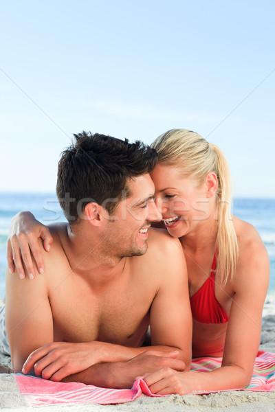 Lovers lying down on the beach Stock photo © wavebreak_media