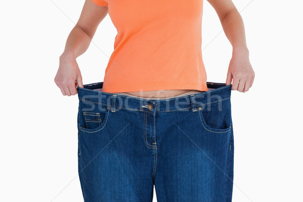 Slim woman showing how much weight she lost Stock photo © wavebreak_media
