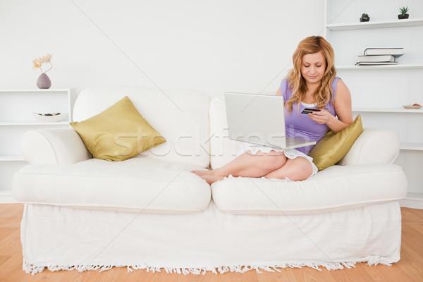 Güzel bir kadın oturma kanepe ödeme Internet Stok fotoğraf © wavebreak_media