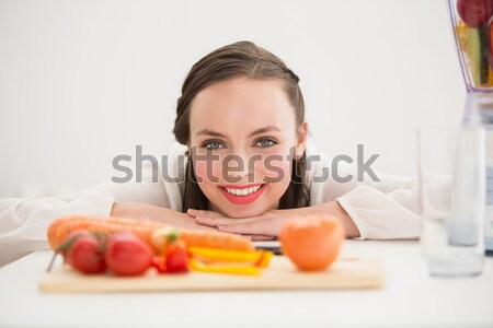 Attractive woman posing with a donut and a green apple in the kitchen Stock photo © wavebreak_media