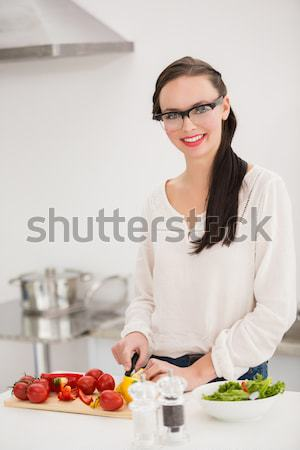Woman sitting at a table with wine for lunch in a kitchen Stock photo © wavebreak_media