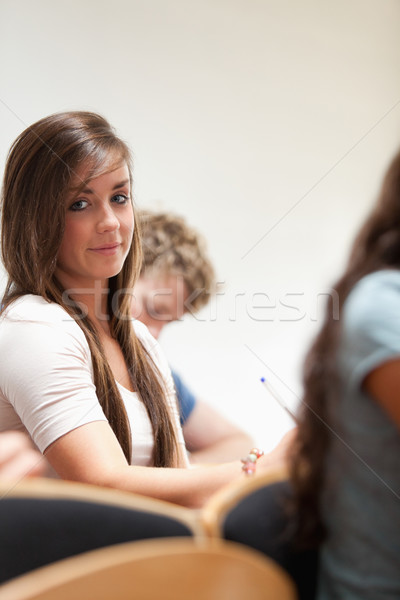Portrait of a distracted student sitting in an amphitheater Stock photo © wavebreak_media