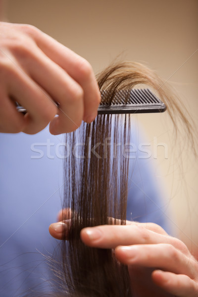 Close up of a hand combing hair with a comb Stock photo © wavebreak_media
