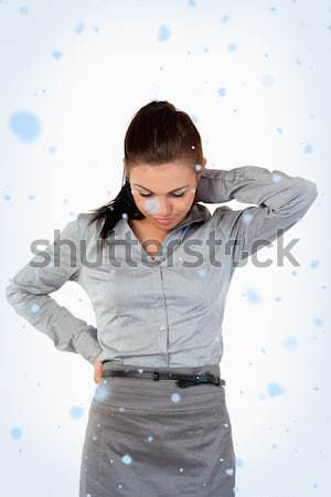 Portrait of a sad businesswoman having back pain against a white background Stock photo © wavebreak_media