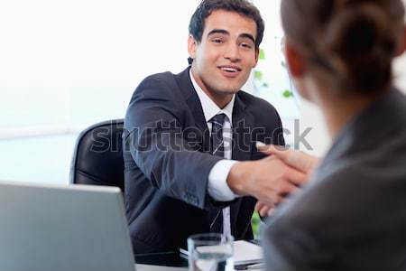 Smiling manager interviewing a female applicant in his office Stock photo © wavebreak_media