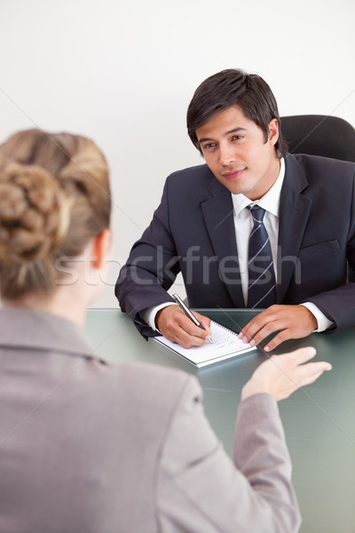 Portrait of a smiling manager interviewing a female applicant in an office Stock photo © wavebreak_media