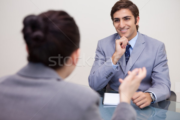 Smiling young businessman in a negotiation Stock photo © wavebreak_media
