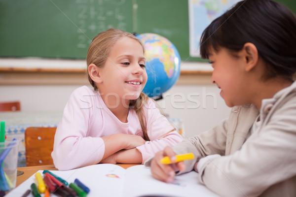 Happy schoolgirls drawing in a classroom Stock photo © wavebreak_media