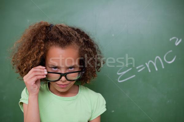Schülerin schauen über Gläser Tafel Schule Stock foto © wavebreak_media
