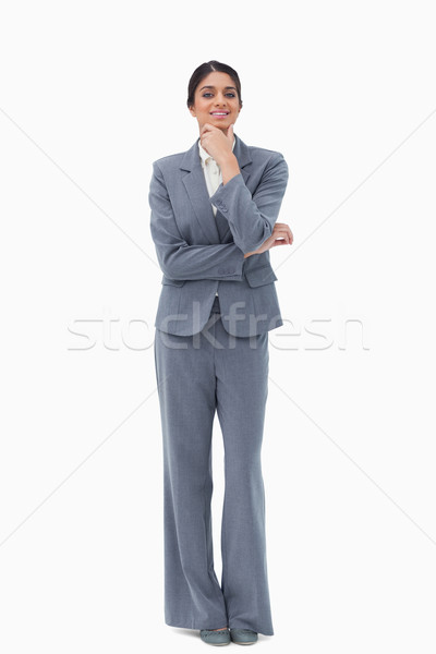 Smiling saleswoman in thoughts against a white background Stock photo © wavebreak_media