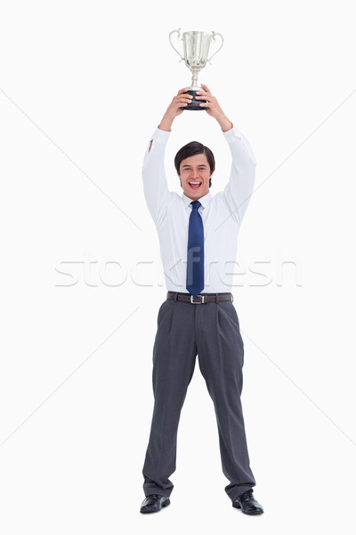 Successful tradesman holding cup against a white background Stock photo © wavebreak_media